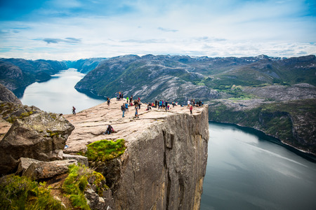 NORWAY- June 22, 2015: Preikestolen or Prekestolen, also known by the English translations of Preacher's Pulpit or Pulpit Rock, is a famous tourist attraction in Forsand, Ryfylke, Norway 에디토리얼