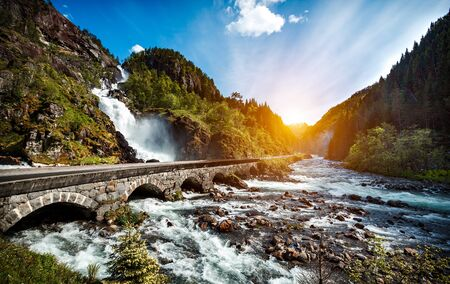 norway: Latefossen Waterfall Odda Norway. Latefoss is a powerful, twin waterfall.