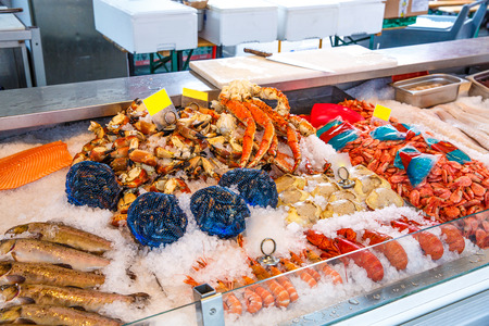 fresh fish: Various seafood on the shelves of the fish market in Norway, Bergen