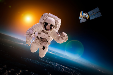 space: Astronaut in outer space against the backdrop of the planet earth Stock Photo