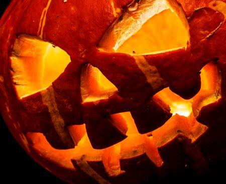 hollows: Halloween, old jack o lantern on black background
