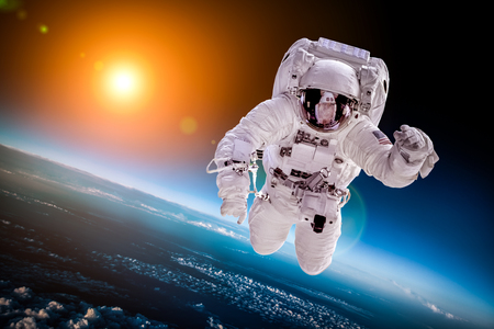 future space: Astronaut in outer space against the backdrop of the planet earth Stock Photo