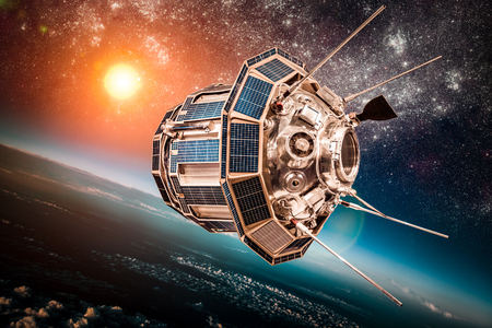 orbiting: Space satellite orbiting the earth on a background star sun. Elements of this image furnished by NASA.