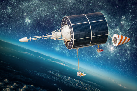 orbiting: Space satellite orbiting the earth. Elements of this image furnished by NASA. Stock Photo