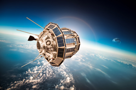 researching: Space satellite orbiting the earth Stock Photo