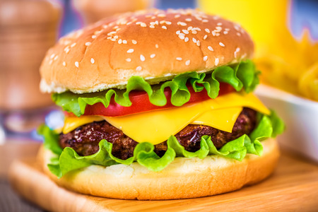 cheeseburger with fries: Tasty and appetizing hamburger cheeseburger Stock Photo