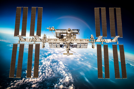 international: International Space Station over the planet earth. Elements of this image furnished by NASA.