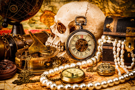 Vintage grunge still life. Vintage items on ancient map. 版權商用圖片