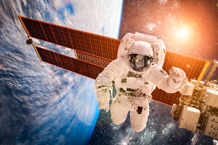 international: International Space Station and astronaut in outer space over the planet Earth. Elements of this image furnished by NASA.