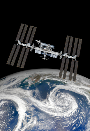 orbital spacecraft: International Space Station over the planet earth. Elements of this image furnished by NASA.