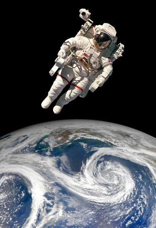 Astronaut in outer space against the backdrop of the planet earth. Elements of this image furnished by NASA. Foto de archivo