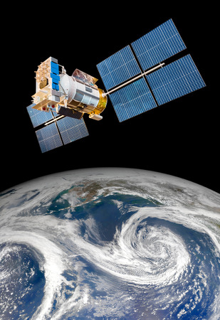 satellite space: Space satellite orbiting the earth. Elements of this image furnished by NASA. Stock Photo