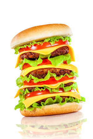 grilled meat: Tasty and appetizing hamburger on a white background