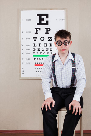 medical attendance: person wearing spectacles in an office at the doctor
