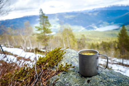 crusade: Travel titanium cup. Lunch during the journey to the wild. Camping lifestyle. Stock Photo