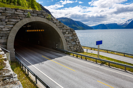 tunnel view: Mountain road in Norway. The entrance to the tunnel.