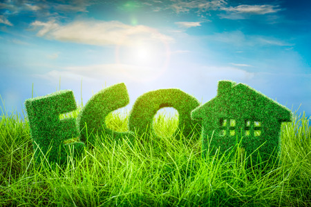 Letters on the and Little House green grass on blue background. Eco concept.
