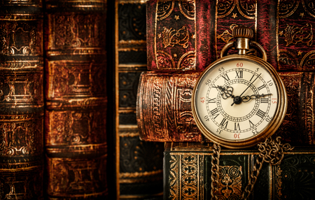 pocket book: Vintage Antique pocket watch on the background of old books