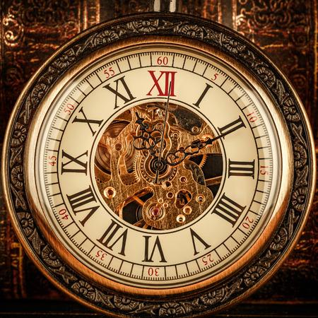 abstract alarm clock: Antique clock dial close-up. Vintage pocket watch.