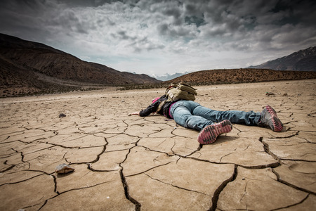 hot climate: Traveller lays on the dried ground