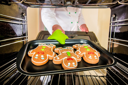 christmas baker's: Baking Gingerbread man in the oven, view from the inside of the oven. Cooking in the oven.