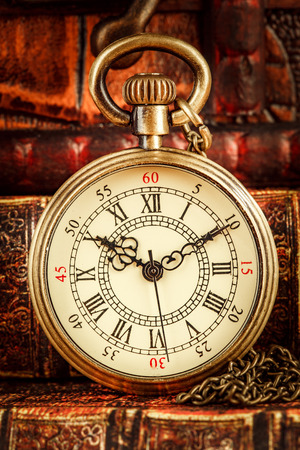 pocketwatch: Vintage Antique pocket watch on the background of old books
