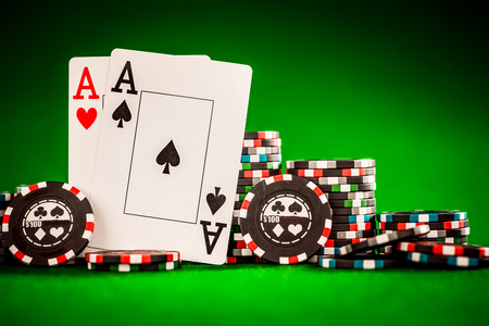 ace of spades: Stack of chips and two aces on the table on the green baize - poker game concept