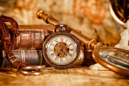 antique books: Vintage Antique pocket watch on the background of old books