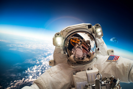 planet earth: Astronaut in outer space against the backdrop of the planet earth. Elements of this image furnished by NASA. Stock Photo