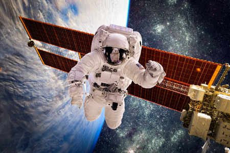 earth space: Astronaut in outer space against the backdrop of the planet earth. Elements of this image furnished by NASA. Stock Photo