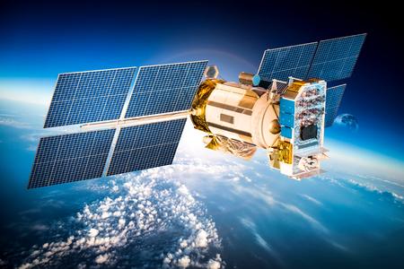 satellite: Space satellite orbiting the earth.  Stock Photo