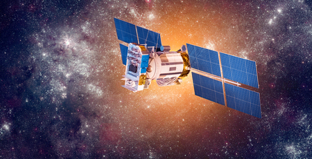 satellite in space: Space satellite orbiting the earth.  Stock Photo