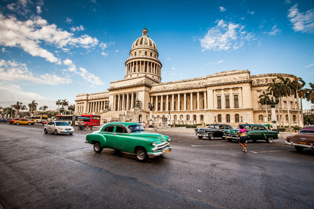 downtown capitol: HAVANA, CUBA - JUNE 7, 2011: Old classic American car rides in front of the Capitol Havana. Before a new law issued on October 2011, cubans could only trade cars that were on the road before 1959.