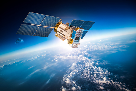 orbital spacecraft: Space satellite orbiting the earth.  Stock Photo