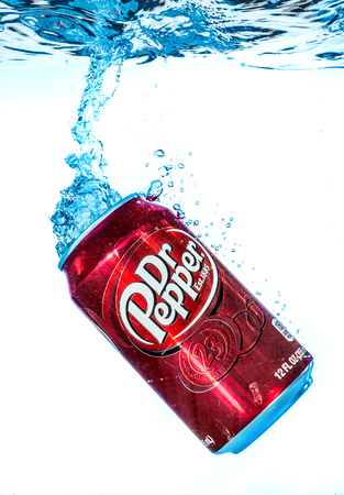 marketed: MOSCOW, RUSSIA-APRIL 4, 2014: Can of Dr Pepper Cherry Vanilla soft drink in water. Dr Pepper is a soft drink marketed as having a unique flavor. The drink was created in the 1880s.