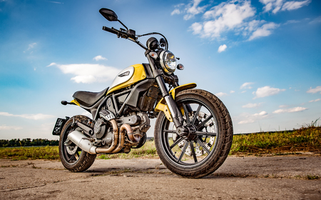 scrambler: RUSSIA-AUGUST 11, 2015: Scrambler Icon - Ducati. A new Ducati Scrambler was introduced at the 2014 Intermot motorcycle show. Ducati is an Italian company that designs and manufactures motorcycles.