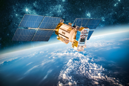 telecommunications: Space satellite orbiting the earth.  Stock Photo