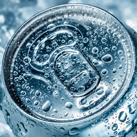 refrigerate: Can of soft drink on ice.