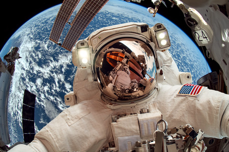 International Space Station and astronaut in outer space over the planet Earth  Foto de archivo