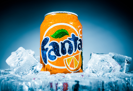 carbonated: MOSCOW, RUSSIA-APRIL 4, 2014: Can of Coca Cola company soft drink Fanta Orange on ice. Fanta is a global brand of fruit-flavored carbonated soft drinks created by The Coca-Cola Company. Editorial