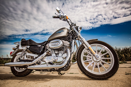 harley: RUSSIA-JULY 7, 2013: Harley-Davidson Sportster 883 Low. Harley-Davidson sustains a large brand community which keeps active through clubs, events, and a museum. Filter applied in post-production.