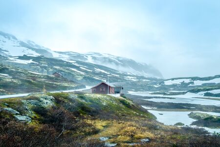 inclement: Norway landscape, a small village in inclement weather snowstorm and fog in the mountains. Beautiful Nature Norway.