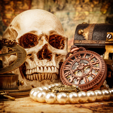 ancient paper: Vintage grunge still life. Vintage items on ancient map. Stock Photo