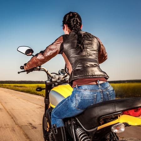biker girl: Biker girl in a leather jacket on a motorcycle