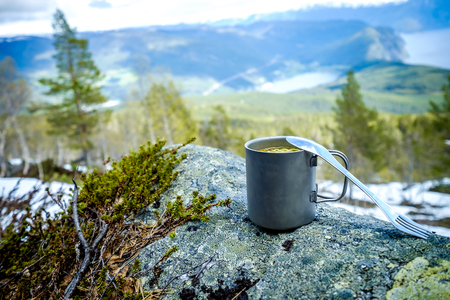 titanium: Travel titanium cup. Lunch during the journey to the wild. Camping lifestyle. Stock Photo