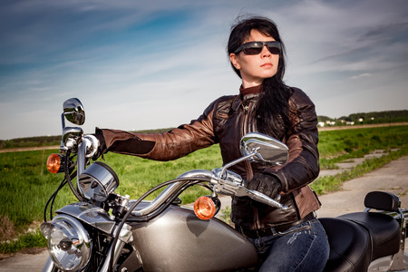 woman street: Biker girl with sunglasses sitting on motorcycle