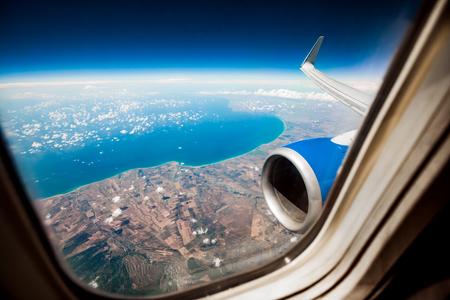 airplane engine: Classic image through aircraft window onto jet engine Stock Photo