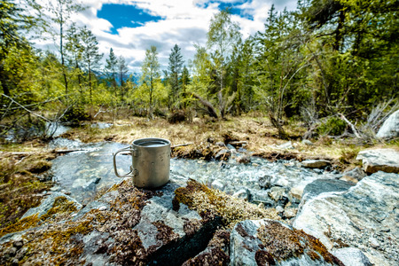 fount: Travel titanium cup. Lunch during the journey to the wild. Camping lifestyle. Stock Photo