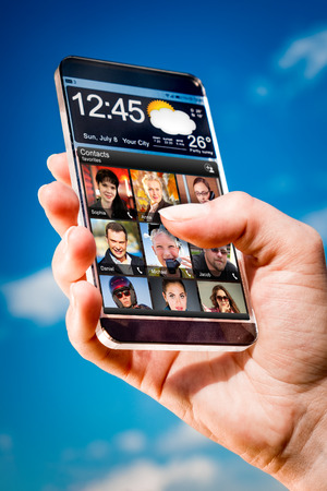 actual: Futuristic Smart phone (phablet) with a transparent display in human hands. Concept actual future innovative ideas and best technologies humanity.