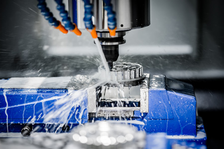 cutting metal: Metalworking CNC milling machine. Cutting metal modern processing technology. Stock Photo